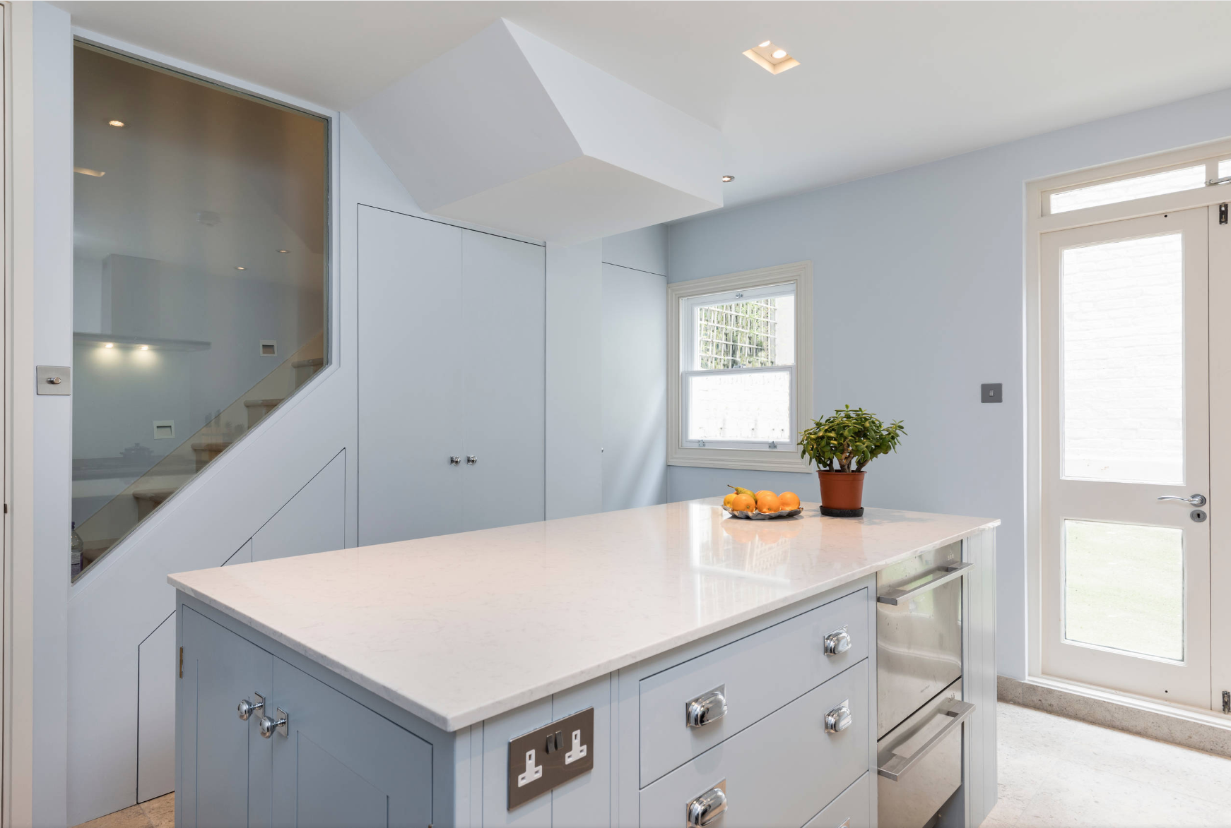 Light blue kitchen designed and build by Holland Street Kitchens, displaying kitchen island with beautiful quartz countertop